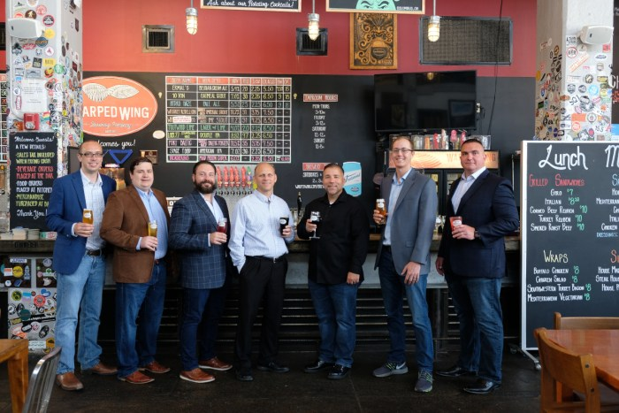 Infinity Labs LLC cofounders from left to right: Nick Marquart, Joe Kirby, Jason Molnar, Dr. Ken Edge, Dr. Nick Kuprowicz, Kurt Glendenning, and Jason Klein at Warped Wing brewery celebrating innovation in Dayton at the company launch.
