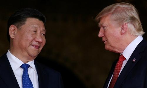 Tổng thống Mỹ Trump (phải) và Chủ tịch Trung Quốc Tập Cận Bình tại Florida tháng 4/2017. Ảnh: Reuters.