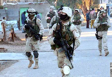Paratroopers assigned to the 82nd Airborne Division's Company B, 1st Battalion, 505th Parachute Infantry Regiment, conduct a dismounted patrol in Fallujah, Iraq, in January 2004.