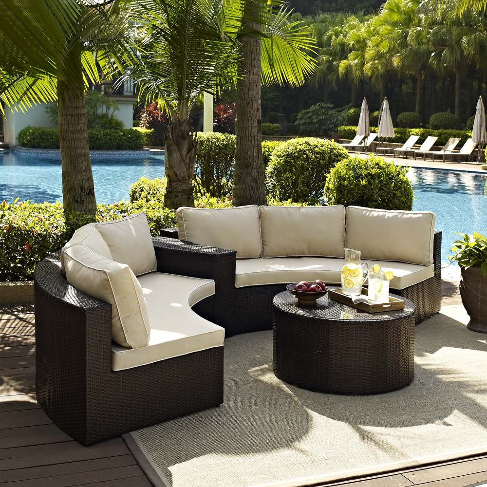 crosley furniture catalina 4 piece outdoor wicker seating set with sand cushions two round sectional sofas arm table and round glass top coffee