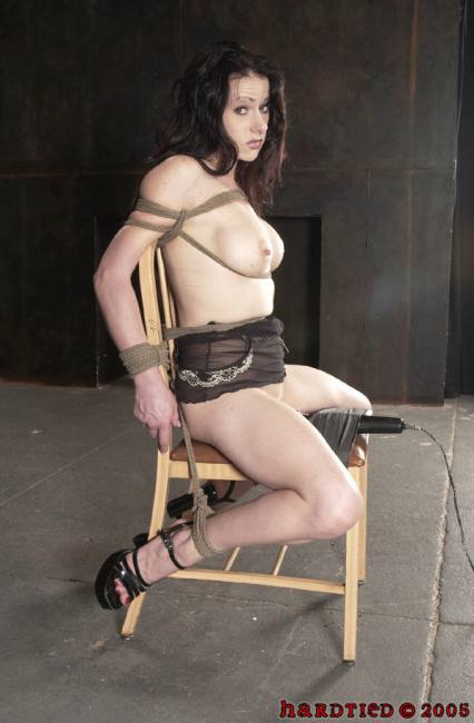 bondage model tied in a chair and exploding into a 5