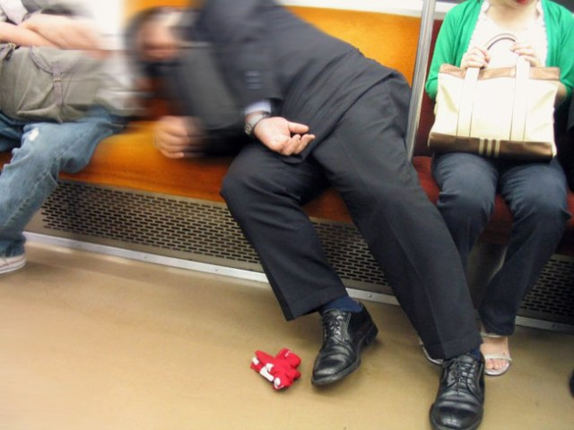 Salaryman Asleep On The Tokyo Subway