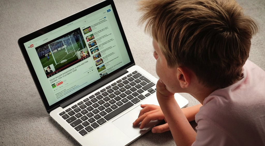 Boy Watching Youtube On Laptop