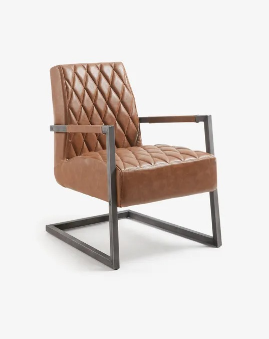 Armchair with padded seat upholstered in brown synthetic leather with an aged finish