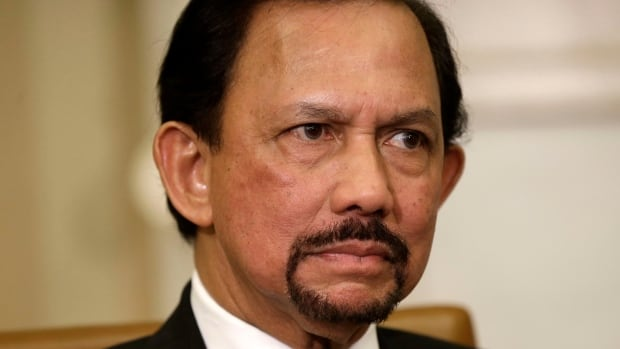 """Brunei's Sultan Hassanal Bolkiah says the country's new criminal law, including penalties like amputation for theft, will be """"part of the great history"""" of the country."""