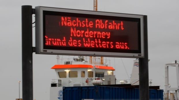 "A sign in Norddeich, Germany, for the ferry to Norderney island reads ""Next departure to Norderney cancelled due to weather."" The North Sea beach town was preparying for the arrival of Xaver, expected to bring strong winds and high tides."