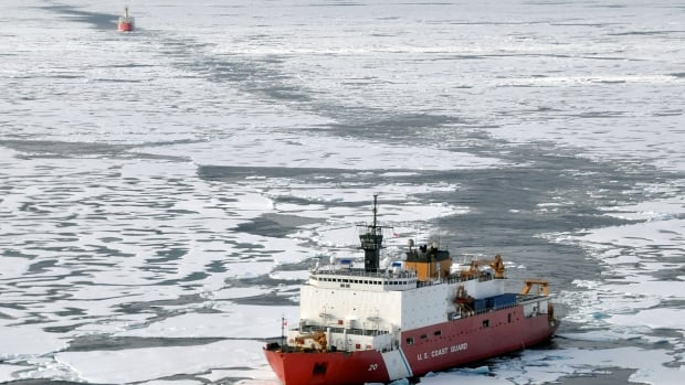 The U.S. Coast Guard Cutter Healy breaks ice ahead of the Canadian Coast Guard Ship Louis S. St-Laurent in the Arctic Ocean. The two ships were taking part in a multi-year, multi-agency Arctic survey that will help define the Arctic continental shelf.