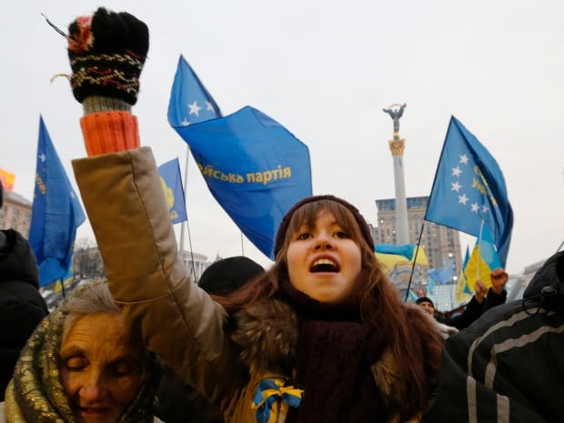 Pro-European integration protesters take part in a rally at Independence Square in Kyiv on Dec. 15, 2013. Thousands gathered on Sunday for a rally against President Viktor Yanukovich just days before he heads for a meeting at the Kremlin which the opposition fears will slam the door on integration with the European Union.