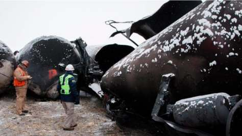 Damaged rail cars in Casselton, N.D.  from a train that derailed on Dec. 30, 2013. States and railroads are wrestling over whether oil shipment information can be disclosed.