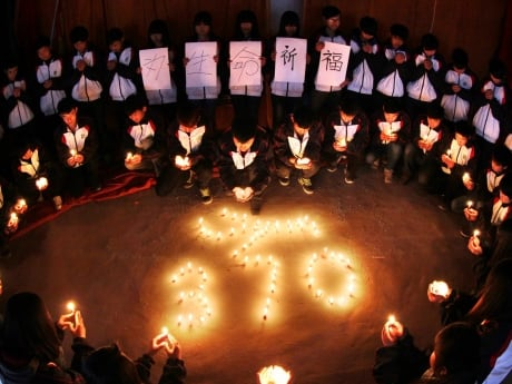 Middle school students pray for passengers aboard Malaysia Airline MH370 in Lianyungang, China, on March 25. The search for the Malaysian airliner that disappeared 18 days ago resumed on Wednesday in the southern Indian Ocean.