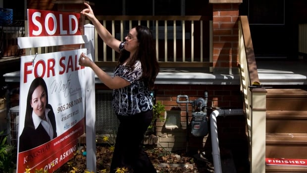 Debt experts worry even lower lending rates will tempt some Canadians to pile on more debt.