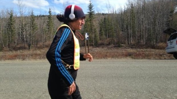 Gwich'in runner Brad Firth, nicknamed Caribou Legs, nears Whitehorse on Monday, after running for nearly a month from Inuvik, N.W.T. He is expected to arrive in Yukon's capital today carrying letters of protest against development in the Peel River watershed.