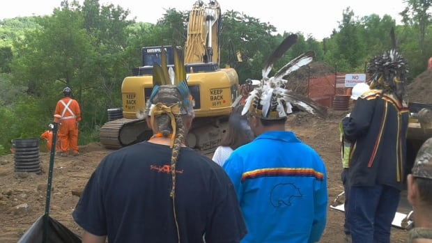 Six Nation members protest an integrity dig for Enbridge's Line 9 pipeline in North Dumfries.