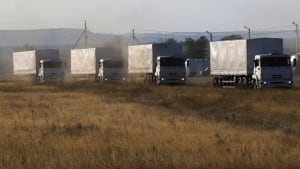 Russian aid convoy: Trucks of a Russian convoy carrying humanitarian aid for Ukraine drive before parking at a camp near Donetsk, Ukraine. (Alexander Demianchuk/Reuters)