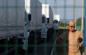 Russia Ukraine: A truck driver from the Russian aid convoy stands in the Russian inspection zone inside a border control point with Ukraine in the Russian town of Donetsk. (Sergei Grits/Associated Press)