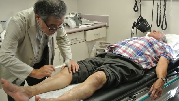 Dr. Akitomo Shimoji, a Japanese doctor who specializes in neurology and psychiatry among victims of mercury poisoning, performs a skin sensitivity test on Grassy Narrows resident Bill Fobister.