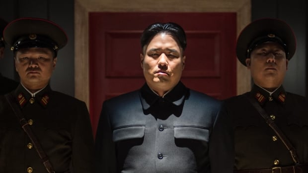 Actor Randall Park, centre, plays Kim Jong-un in Sony's controversial movie The Interview. A South Korean activist says he plans to float copies of the film over the border using balloons.