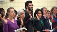 New Canadians take the oath of citizenship at a ceremony in Dartmouth, N.S., in 2014. A new Statistics Canada study finds immigrants are more likely to create businesses than the Canadian-born people.