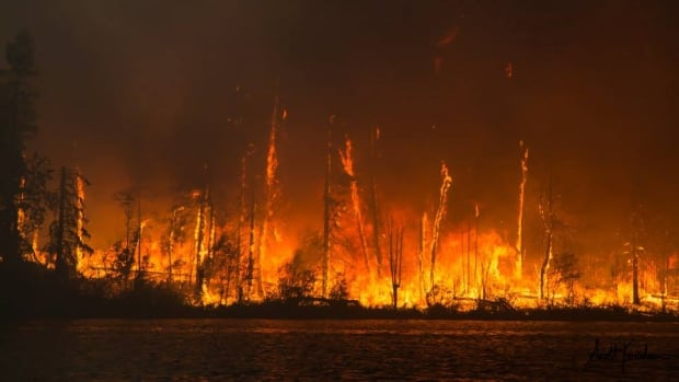 B.C. and the Prairies have been scorched by wildfires this year. Here, a fire tears through a peninsula jutting out onto Lac La Ronge, Sask., in July.
