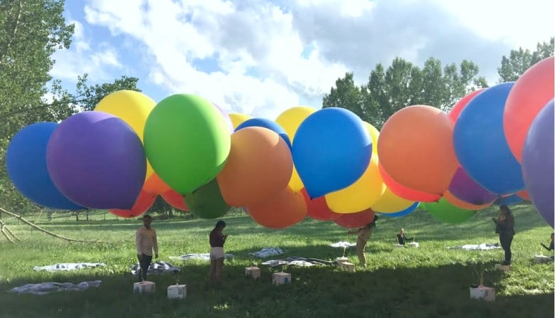 chair with balloons slipper chairs ikea calgary s balloon man describes soaring over city in lawn each of the some 100 helium boria used to carry him were about two metres high submitted by conner shauf