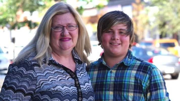 Kathy Moreland and her son Austin Layte. Austin has Fetal Alchohol Spectrum Disorder (FASD), but a specialized classroom regime has meant he not only stays in school, he thrives.