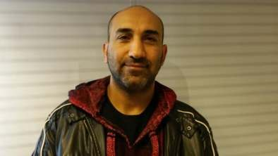 Chadi Alhelou, seen visiting CBC's Daybreak studio Tuesday, said that the policy will affect his brother's bid to enter Canada.