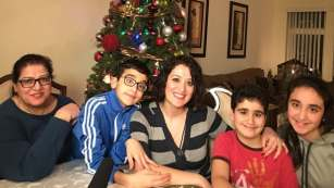 Mirna Nakhleh (centre) and her three children will spend their first Christmas with their grandmother Maryam Hawa (left) in 10 years. Hawa arrived in B.C. as a Syrian refugee last week.