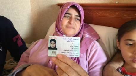 Suzan Kewan holds picture of her 17 year-old daughter who was killed in a bombing in Syria in September 2012.