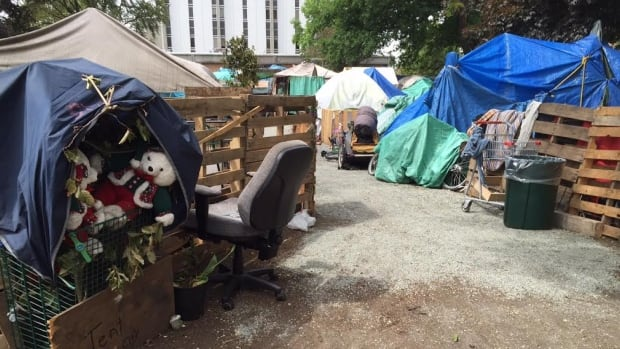 Victoria tent city residents claim the Fire Commissioner issued a destruction order against their makeshift courthouse lawn shelter earlier this week.