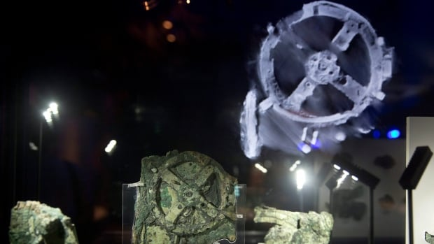 Fragments of the 2,100-year-old Antikythera Mechanism are displayed at the National Archaeological Museum, in Athens. For over a century since its discovery in an ancient shipwreck, the exact function of the Antikythera Mechanism — named after the southern Greek island off which it was found — was a tantalizing puzzle.