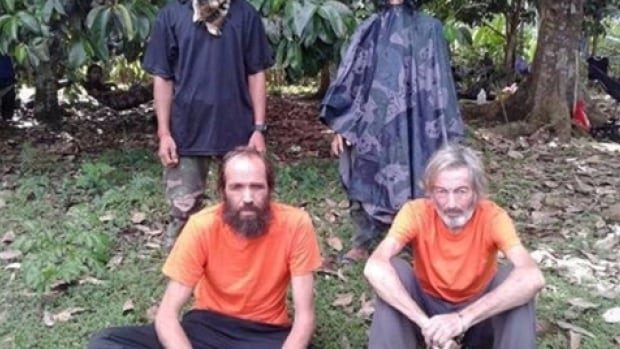 Canadian national Robert Hall, right, and Norwegian Kjartan Sekkingstad, left, are shown in this undated picture released to local media. Islamist militant group, Abu Sayyaf, executed Hall on  June 13.