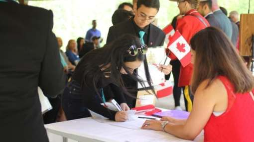 Immigrant Rana El Mansour becomes a Canadian on Canada Day in Kitchener, Ont. Canada must actively recruit economic immigrants, Reis Pagtakhan says.