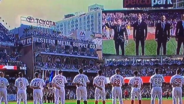 Social media quickly took notice when The Tenors changed the lyrics of the national anthem at the MLB all-star game while a member of the group held up an 'All Lives Matter' sign.