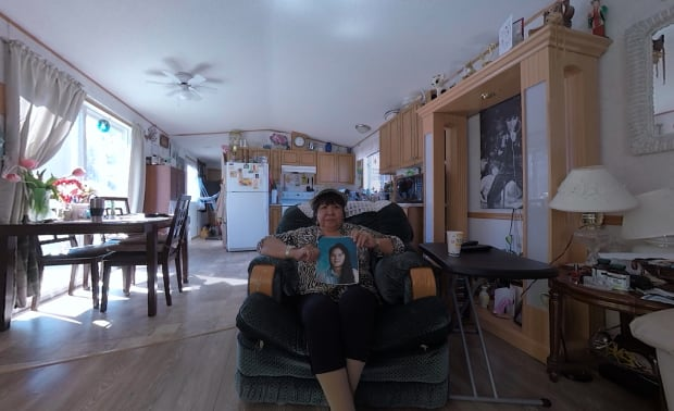 Matilda Wilson holds up a picture of her daughter Ramona at her home in Smithers, B.C. Ramona disappeared in 1994, when she was 16, and her body was found a year later. Her death remains unsolved. (CBC)