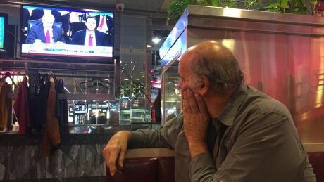 Patron watching Comey hearing