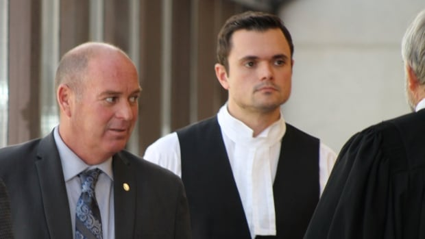 Tom Harding, left, consults with his legal team, Charles Shearson and Tom Walsh, at the Sherbrooke courthouse.