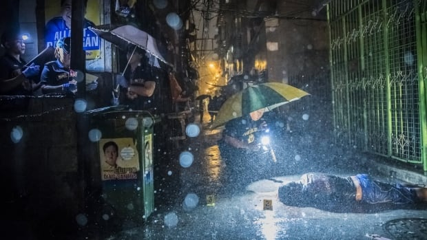 'It's more a war on class than a war on drugs': photojournalist documents unlawful killings in the Philippines   CBC Radio