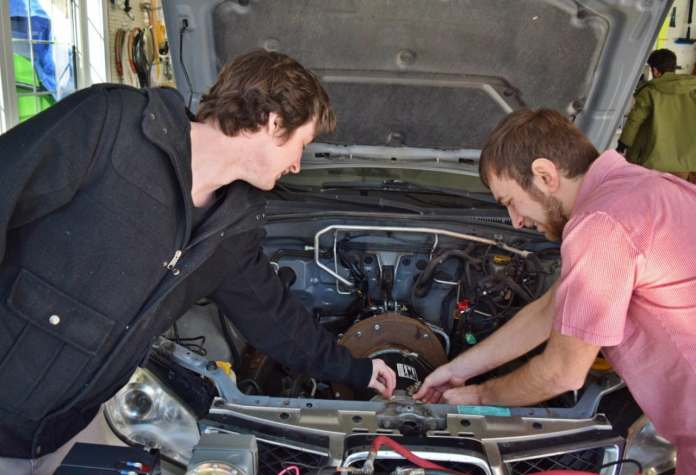 4 unb students tout converting cars to electric their way | cbc news