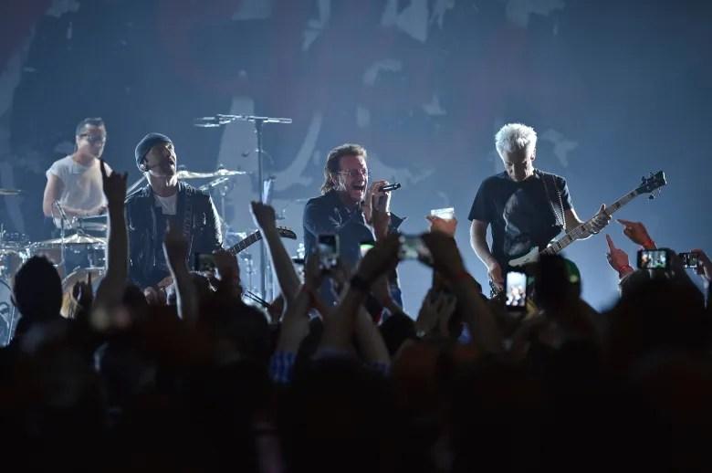 U2 dedicates song to Anthony Bourdain at Apollo show u2 concert at the apollo theater