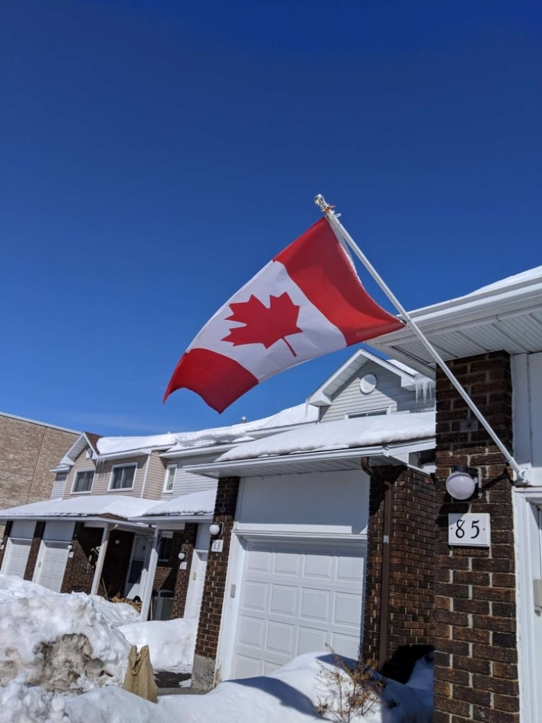 The flag runs afoul of condo board rules that prevent