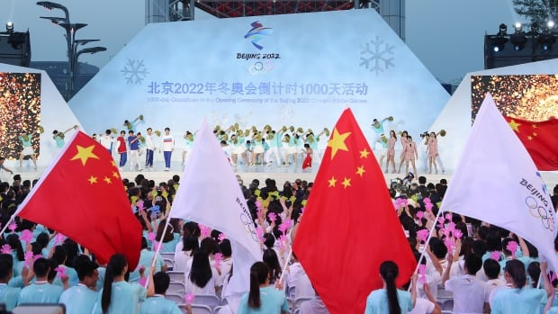 Amid coronavirus fight, Beijing 2022 organizers say they remain on track