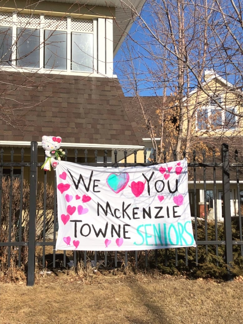 mckenzie towne love sign - 'Lean on me': Loved ones serenade seniors outside care home with COVID-19 outbreak