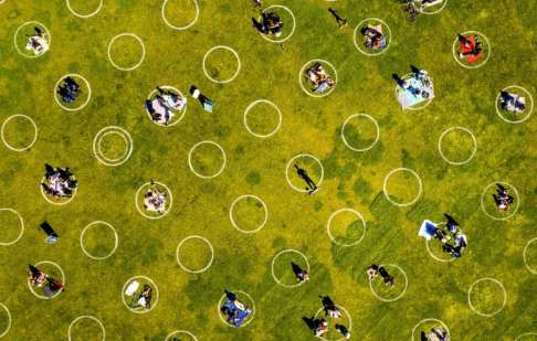 City exploring circles painted on grass to ease physical ...
