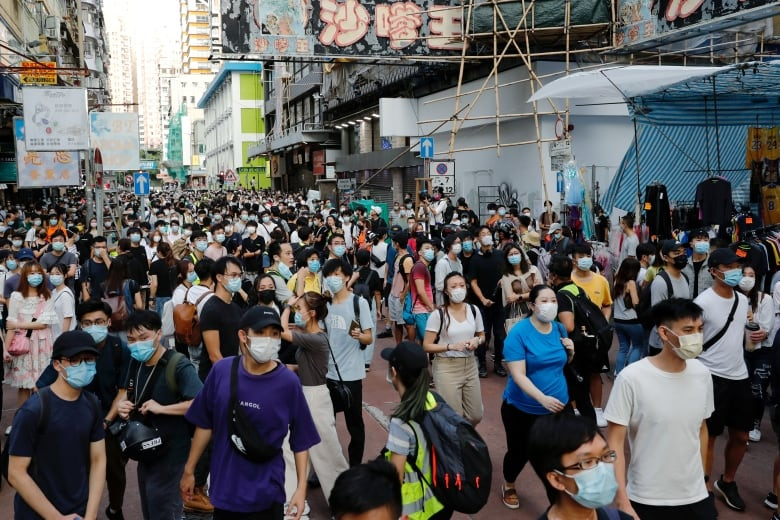 Hong Kong police arrest 289 at protests over election delay   CBC News