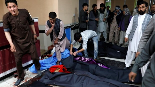 Dozens killed in suicide bombing at Afghan education centre | CBC News