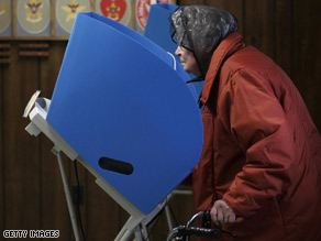 A senior citizen casts her vote in Bloomdale, Ohio.