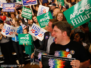 Clinton supporters cheer as they await her victory speech.