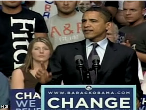 What are the three Abercrombie supporters doing behind Obama?