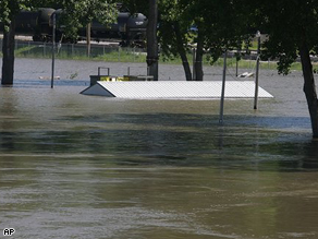 A picnic shelter at the Quincy River Front park shows the water level rising from the Mississippi River near Quincy, Ill.