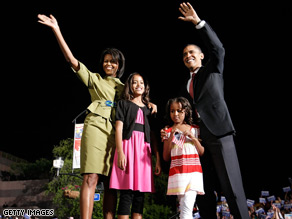 Michelle with her husband and daughters at a campaign event in Iowa last month.